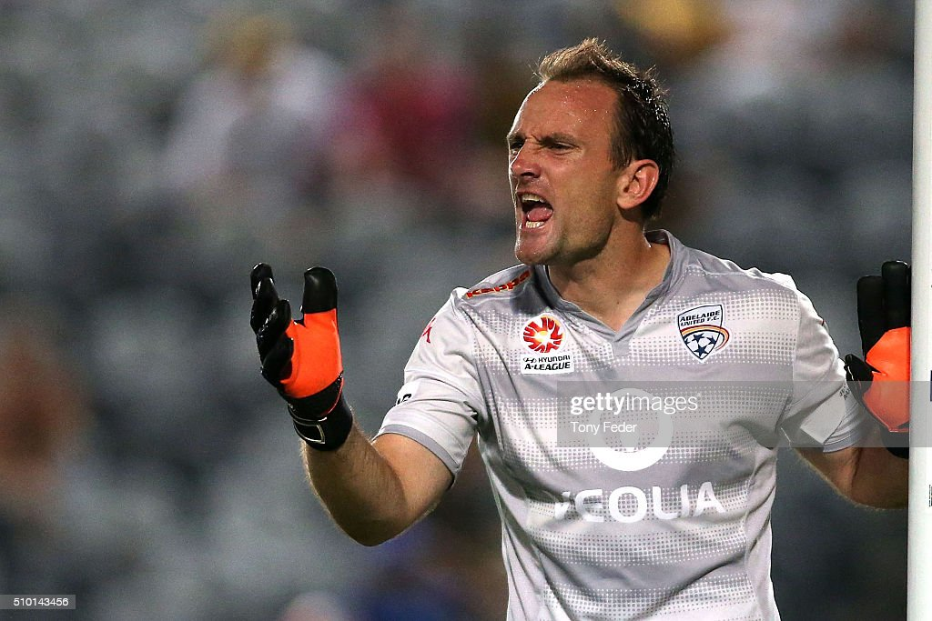 Eugene Galekovic of Adelaide shouts at team mates during the round 19 A-League match between the Central Coast Mariners and Adelaide United at Central Coast Stadium on February 14, 2016 in Gosford, Australia.