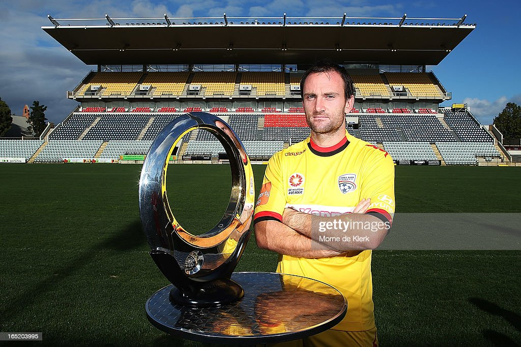 Eugene Galekovic stands with the A-League trophy during the Adelaide United A-League 2013 Finals Series Launch at Hindmarsh Stadium on April 2, 2013 in Adelaide, Australia.