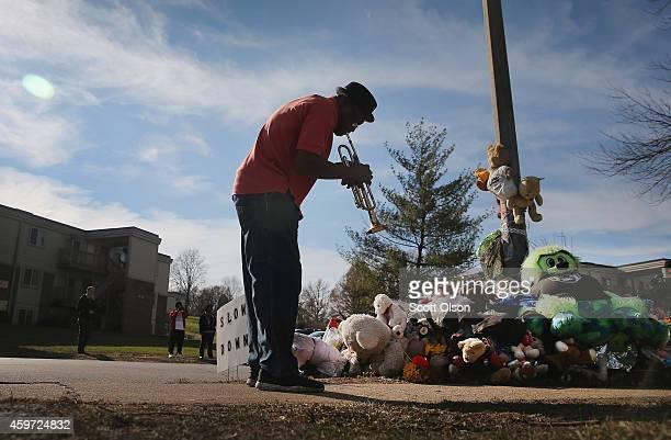Eugene Gillis plays a trumpet at the Michael Brown memorial on November 29 2014 in Ferguson Missouri The Ferguson area has been struggling to return...