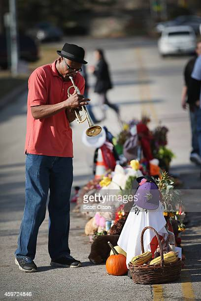 Eugene Gillis plays a trumpet at the Michael Brown memorial on November 29 2014 in Ferguson Missouri The Ferguson area has been struggling to return...
