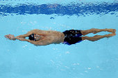 Eugene Godsoe of the USA competes in the final of the Men's 100m Backstroke during the FINA Swimming World Cup at Hamdan Sports Complex on August 31...