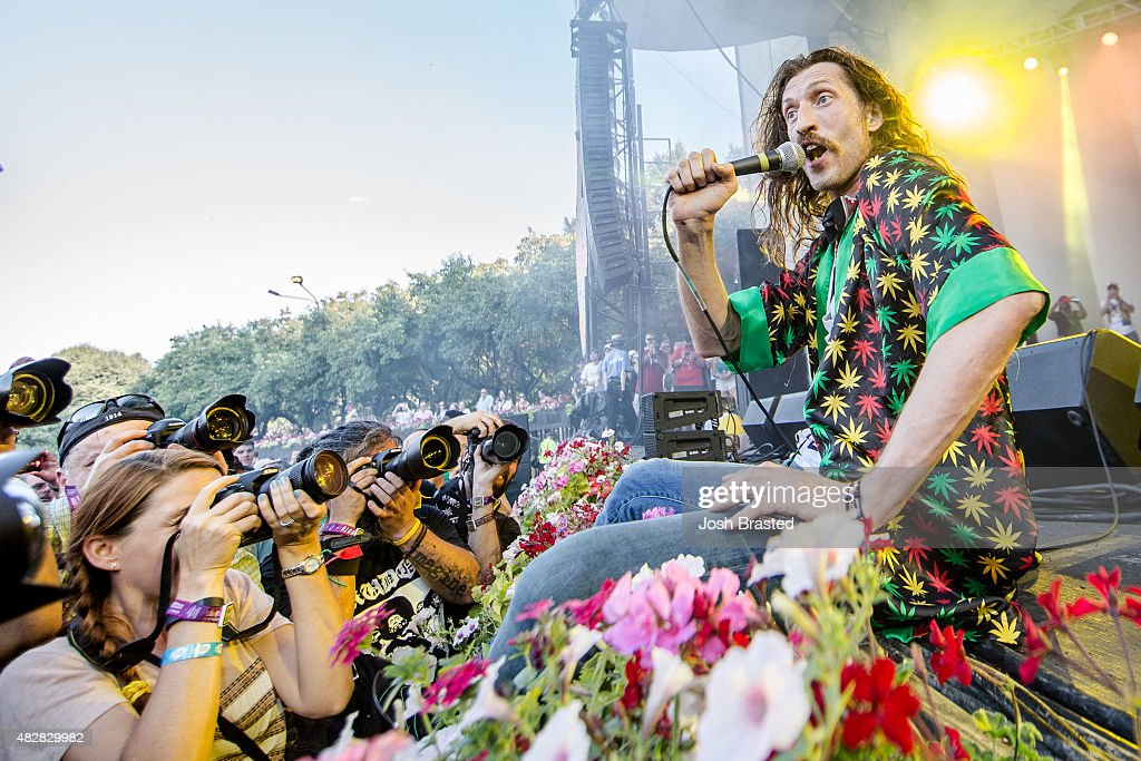 Eugene Hutz of Gogol Bordello performs in the photo pit at Grant Park on August 2, 2015 in Chicago, Illinois.