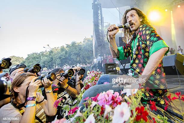 Eugene Hutz of Gogol Bordello performs in the photo pit at Grant Park on August 2 2015 in Chicago Illinois