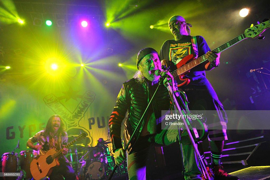 Eugene Hutz Sergey Ryabtsev and Thomas 'Tommy T' Gobena of Gogol Bordello perform on stage at KOKO on July 26 2016 in London England