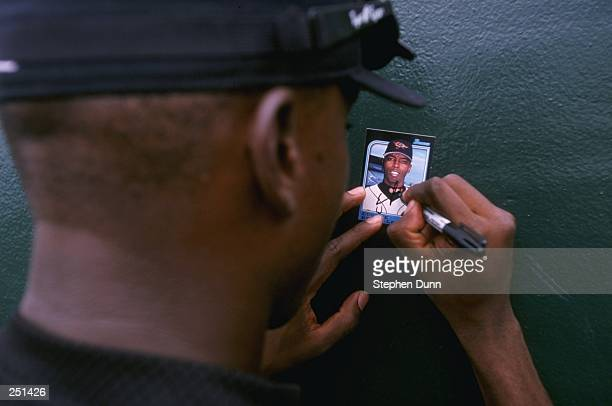 Eugene Kingsdale of the Los Angeles Dodgers signing his Baseball Card for the fans before the spring training game between the Los Angeles Dodgers...