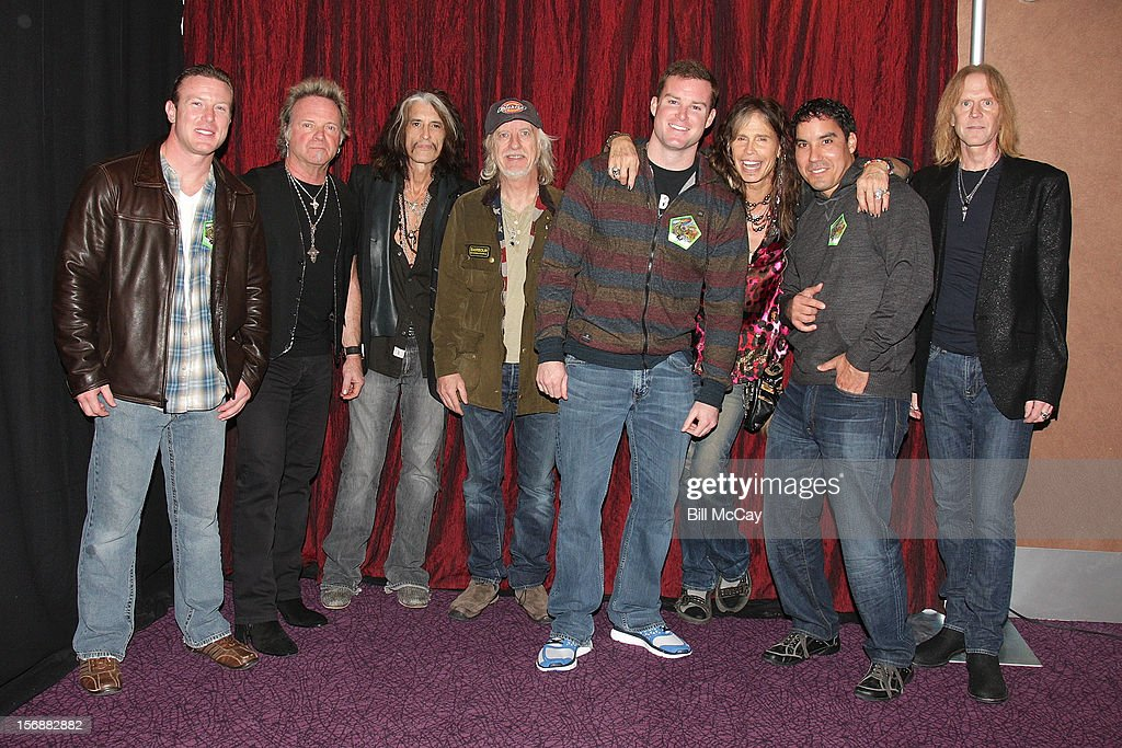Eugene Laielli, Joey Kramer, Joe Perry, Brad White, Darin Lorady, Steven Tyler, Thomas Moynihan and Tom Hamilton attend Aerosmith Meets Atlantic City & Brigantine, New Jersey Hurricane Sandy First Responders at Ovation Hall at Revel Casino November 23, 2012 in Atlantic City, New Jersey.