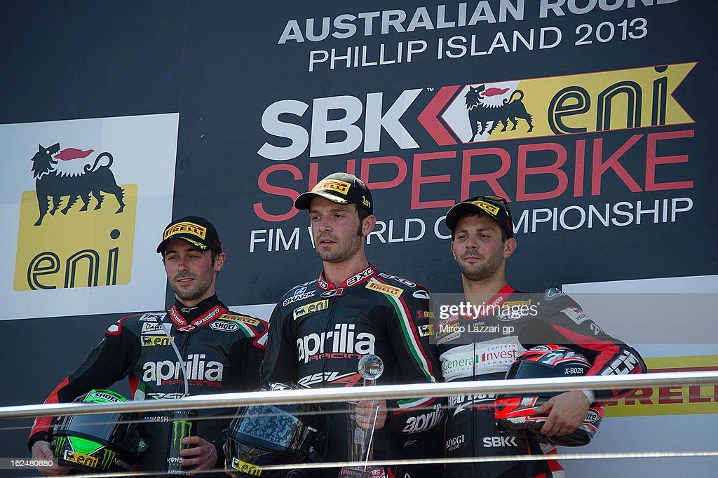 Eugene Laverty of Ireland and Aprilia Racing Team, Sylvain Giuntoli of France and Aprilia Racing Team and Michel Fabrizio of Italy and Red Devils Roma pose on the podium at the end of the race 1 during the round first of 2013 Superbike FIM World Championship at Phillip Island Grand Prix Circuit on February 24, 2013 in Phillip Island, Australia.