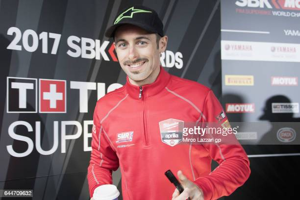 Eugene Laverty of Ireland and Milwaukee Aprilia smiles during the Autograph Session in paddock show during practice ahead of round one of the FIM...