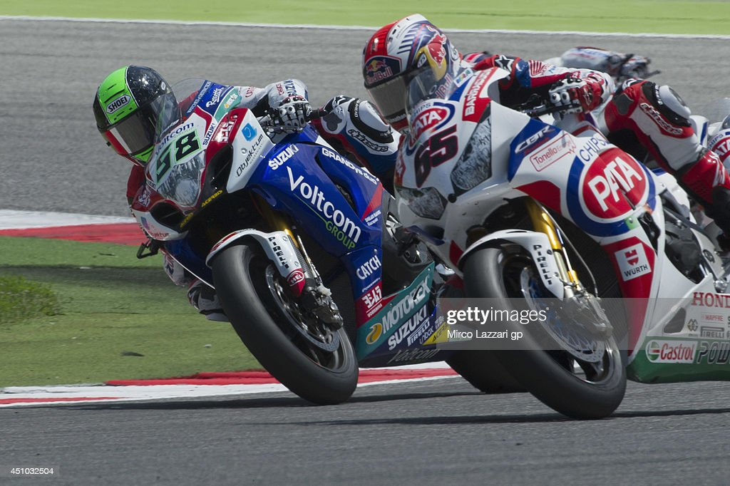 <a gi-track='captionPersonalityLinkClicked' href=/galleries/search?phrase=Eugene+Laverty&family=editorial&specificpeople=4253466 ng-click='$event.stopPropagation()'>Eugene Laverty</a> of Ireland and Voltcom Crescent Suzuki and <a gi-track='captionPersonalityLinkClicked' href=/galleries/search?phrase=Jonathan+Rea&family=editorial&specificpeople=2643129 ng-click='$event.stopPropagation()'>Jonathan Rea</a> of Great Britain and PATA Honda World Superbike round the bend during the Superbike race 2 during the FIM Superbike World Championship - Race at Misano World Circuit on June 22, 2014 in Misano Adriatico, Italy.