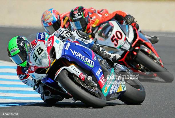 Eugene Laverty of Ireland and Voltcom Crescent Suzuki leads Sylvain Guintoli of France and Aprilia Racing Team in race 1 during round one of the 2014...