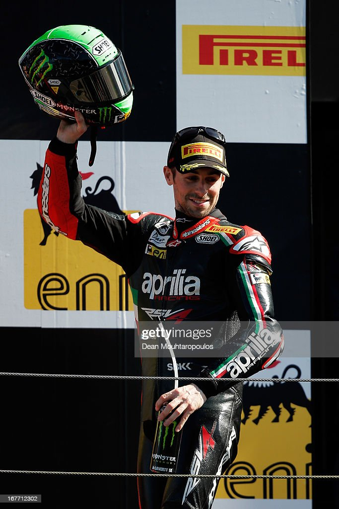 <a gi-track='captionPersonalityLinkClicked' href=/galleries/search?phrase=Eugene+Laverty&family=editorial&specificpeople=4253466 ng-click='$event.stopPropagation()'>Eugene Laverty</a> (#58) of Ireland on the Aprilia RSV4 for the Aprilia Racing Team celebrates winning the World Superbikes Race 2 at TT Circuit Assen on April 28, 2013 in Assen, Netherlands.