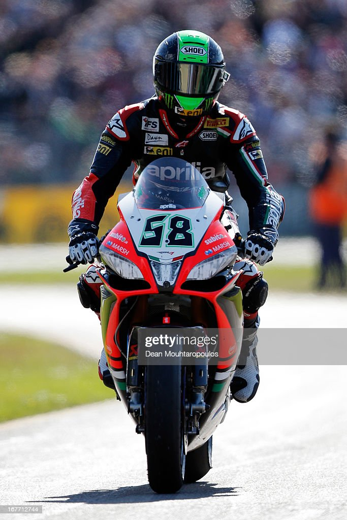 <a gi-track='captionPersonalityLinkClicked' href=/galleries/search?phrase=Eugene+Laverty&family=editorial&specificpeople=4253466 ng-click='$event.stopPropagation()'>Eugene Laverty</a> (#58) of Ireland on the Aprilia RSV4 for the Aprilia Racing Team rides into the pitts after winning the World Superbikes Race 2 at TT Circuit Assen on April 28, 2013 in Assen, Netherlands.