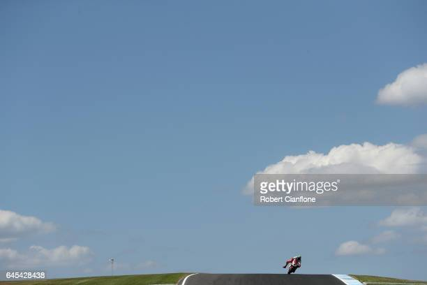 Eugene Laverty of Ireland rides the Milwaukee Aprilia during the warm up lap for race two of round one of the FIM World Superbike Championship at...