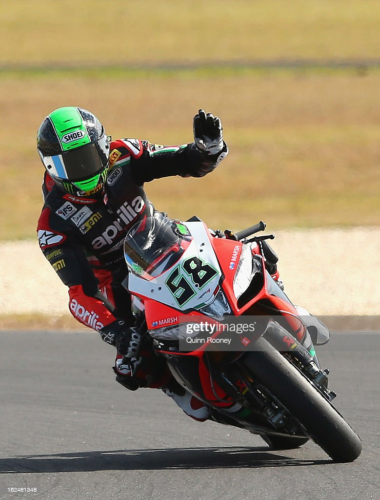 <a gi-track='captionPersonalityLinkClicked' href=/galleries/search?phrase=Eugene+Laverty&family=editorial&specificpeople=4253466 ng-click='$event.stopPropagation()'>Eugene Laverty</a> of Ireland riding the #58 Aprilia Racing Team celebrates winning the World Superbikes Race Two at Phillip Island Grand Prix Circuit on February 24, 2013 in Phillip Island, Australia.