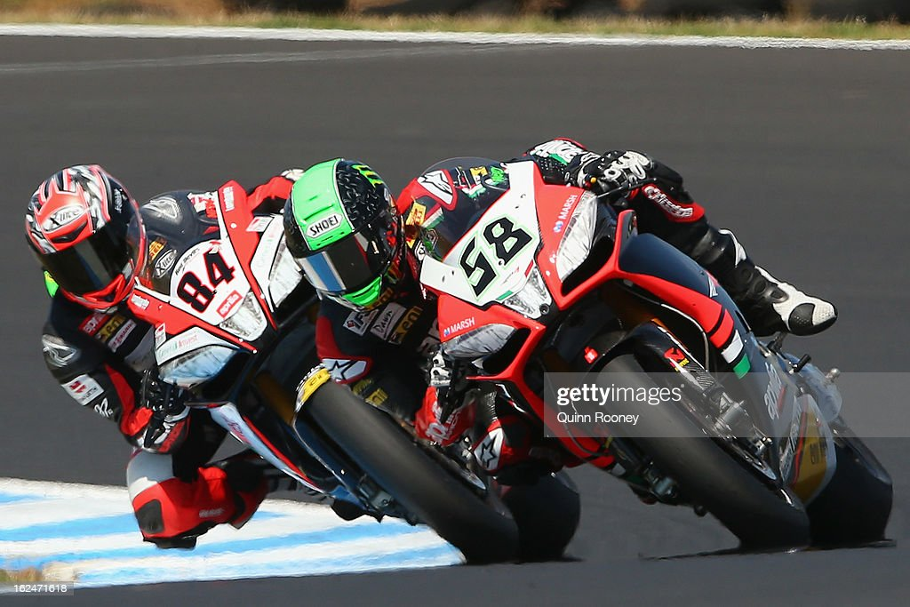Eugene Laverty of Ireland riding the #58 Aprilia Racing Team leads Michel Fabrizio of Italy riding the #84 Red Devils Roma Aprilia during the World Superbikes Race One at Phillip Island Grand Prix Circuit on February 24, 2013 in Phillip Island, Australia.