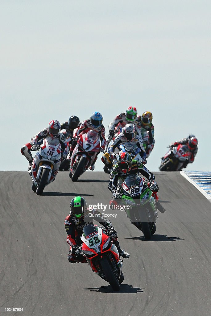 <a gi-track='captionPersonalityLinkClicked' href=/galleries/search?phrase=Eugene+Laverty&family=editorial&specificpeople=4253466 ng-click='$event.stopPropagation()'>Eugene Laverty</a> of Ireland riding the #58 Aprilia Racing Team leads the field during the World Superbikes Race One at Phillip Island Grand Prix Circuit on February 24, 2013 in Phillip Island, Australia.
