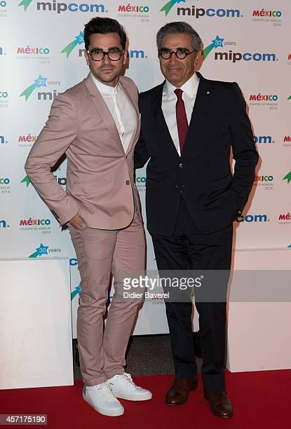 Eugene Levy and Dan Levy attend the opening red carpet party MIPCOM 2014 at Hotel Martinez on October 13 2014 in Cannes France