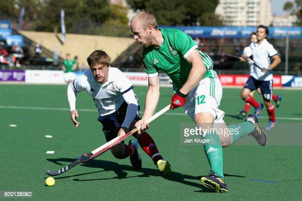 Eugene Magee of Ireland takes the ball past Hugo Genestet of France during the 5th8th place play off match between Ireland and France on Day 7 of the...