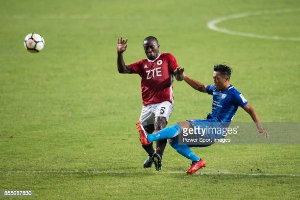 Eugene Mbende Mbome of Pegasus trips up with SC Kitchee Defender Kin Man Tong during the week three Premier League match between Hong Kong Pegasus...