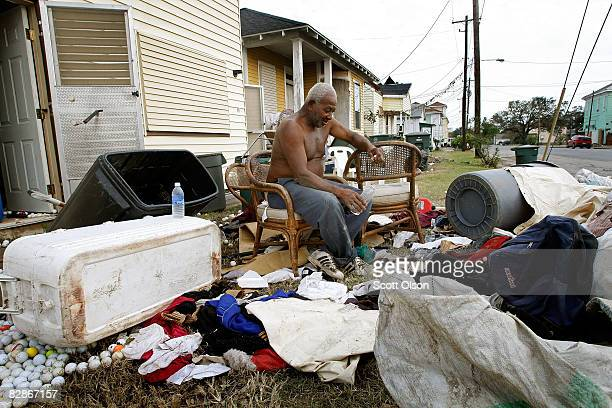 Eugene Richardson dries out his possessions after his home was flooded by Hurricane Ike September 17 2008 in Galveston Texas Most of the island...