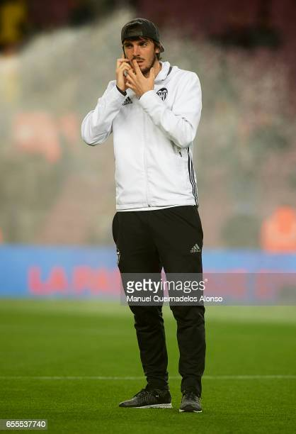 Eugeni Valderrama of Valencia speaks on his mobile phone before the La Liga match between FC Barcelona and Valencia CF at Camp Nou Stadium on March...