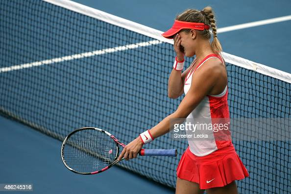 Eugenie Bouchard celebrates after defeating Polona Hercog of Slovenia during their Women's Singles Second Round match on Day Three of the 2015 US...