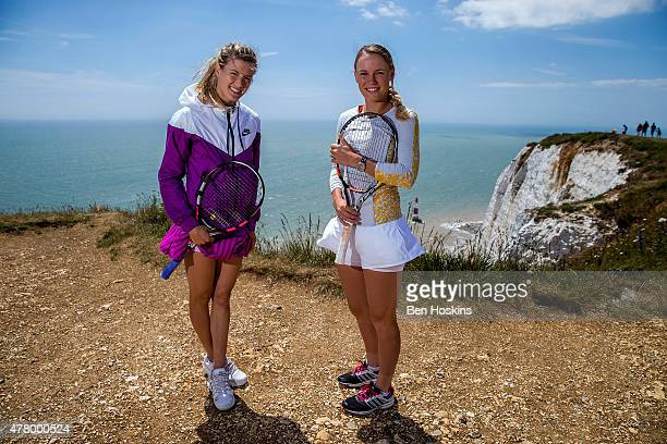 Eugenie Bouchard of Canada and Caroline Wozniacki of Denmark pose for a picture on top of Beachy Head on June 21 2015 in Eastbourne England