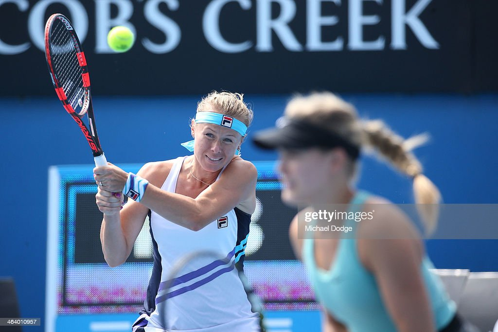 Eugenie Bouchard of Canada and Vera Dushevina of Russia in action in their second round doubles match against Cara Black of Zimbabwe and Sania Mirza...