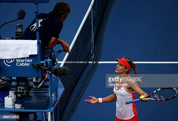 Eugenie Bouchard of Canada argues a call while playing against Dominika Cibulkova of Slovakia during their Women's Singles Third Round match on Day...