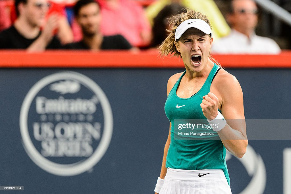 Eugenie Bouchard of Canada celebrates a point against Dominika Cibulkova of Slovakia during day three of the Rogers Cup at Uniprix Stadium on July 27...