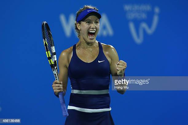 Eugenie Bouchard of Canada celebrates after won the match against Caroline Wozniacki of Denmark on day six of 2014 Dongfeng Motor Wuhan Open at...