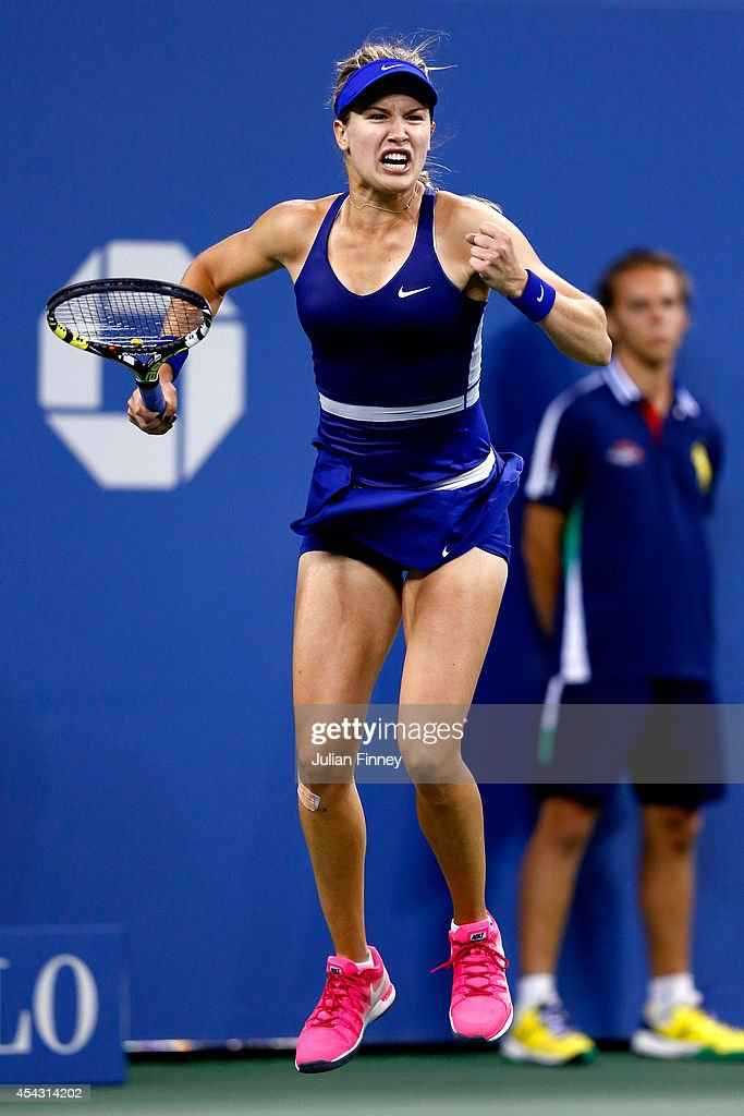 <a gi-track='captionPersonalityLinkClicked' href=/galleries/search?phrase=Eugenie+Bouchard&family=editorial&specificpeople=5678779 ng-click='$event.stopPropagation()'>Eugenie Bouchard</a> of Canada celebrates match point against Sorana Cirstea of Romania on Day Four of the 2014 US Open at the USTA Billie Jean King National Tennis Center on August 28, 2014 in the Flushing neighborhood of the Queens borough of New York City.