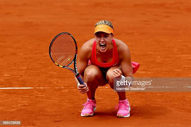 Eugenie Bouchard of Canada celebrates match point during her women's singles quarterfinal match against Carla Suarez Navarro of Spain on day ten of...