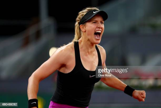 Eugenie Bouchard of Canada celebrates match point in her match against Maria Sharapova of Russia on day three of the Mutua Madrid Open tennis at La...
