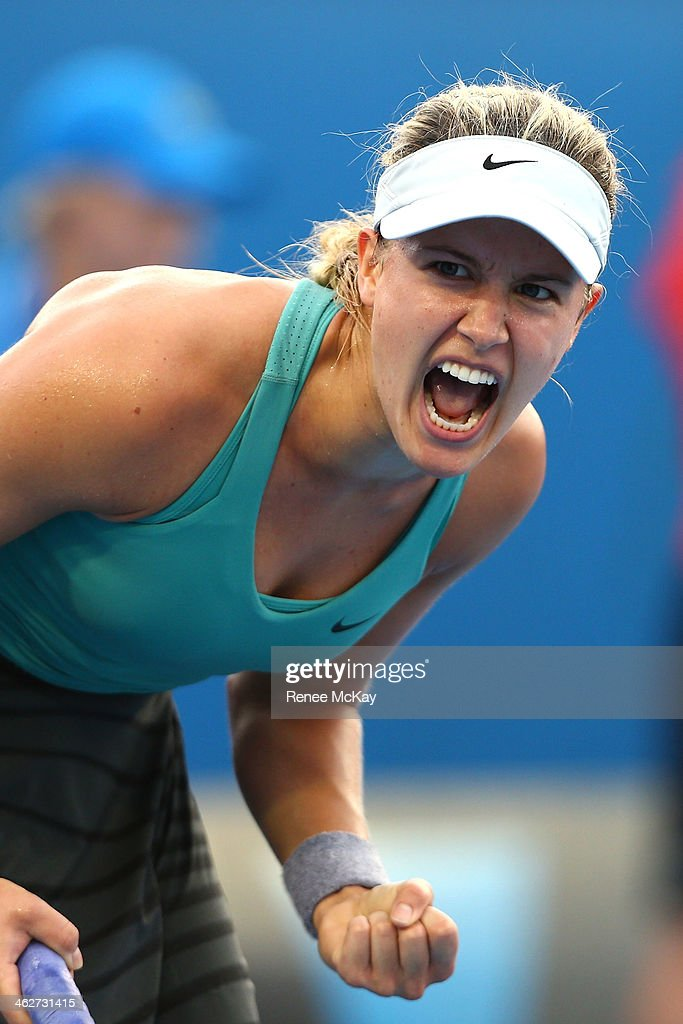 <a gi-track='captionPersonalityLinkClicked' href=/galleries/search?phrase=Eugenie+Bouchard&family=editorial&specificpeople=5678779 ng-click='$event.stopPropagation()'>Eugenie Bouchard</a> of Canada celebrates winning her second round match against Virginie Razzano of France during day three of the 2014 Australian Open at Melbourne Park on January 15, 2014 in Melbourne, Australia.