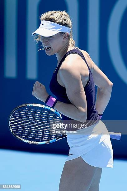 Eugenie Bouchard of Canada celebrates winning the first set in her second round match against Dominika Cibulkova of Slovakia during day three of the...