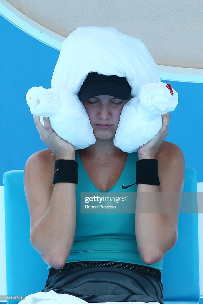 <a gi-track='captionPersonalityLinkClicked' href=/galleries/search?phrase=Eugenie+Bouchard&family=editorial&specificpeople=5678779 ng-click='$event.stopPropagation()'>Eugenie Bouchard</a> of Canada cools off during a break in her third round match against Lauren Davis of the United States during day five of the 2014 Australian Open at Melbourne Park on January 17, 2014 in Melbourne, Australia.