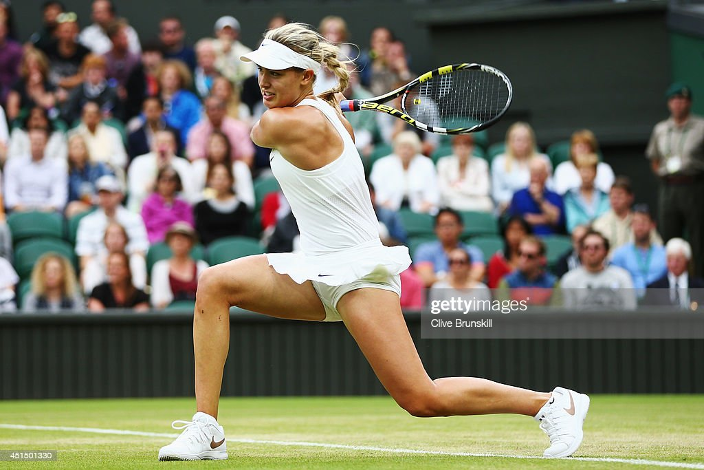 <a gi-track='captionPersonalityLinkClicked' href=/galleries/search?phrase=Eugenie+Bouchard&family=editorial&specificpeople=5678779 ng-click='$event.stopPropagation()'>Eugenie Bouchard</a> of Canada hits a backhand return during her Ladies' Singles fourth round match against Alize Cornet of France on day seven of the Wimbledon Lawn Tennis Championships at the All England Lawn Tennis and Croquet Club on June 30, 2014 in London, England.