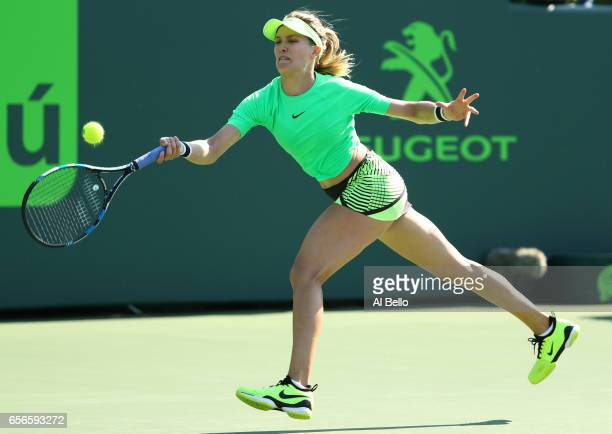 Eugenie Bouchard of Canada in action against Ashleigh Barty of Australia during day 3 of the Miami Open at Crandon Park Tennis Center on March 22...