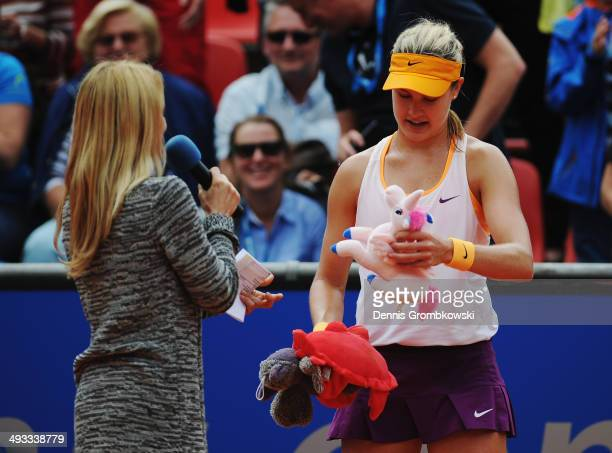 Eugenie Bouchard of Canada looks at stuffed animals after her match during Day 7 of the Nuernberger Versicherungscup on May 23 2014 in Nuremberg...