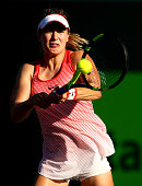 Eugenie Bouchard of Canada plays a backhand against Lucie Hradecka of the Czech Republic in their first round match during the Miami Open Presented...