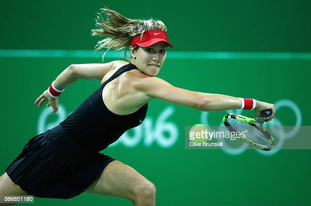 Eugenie Bouchard of Canada plays a backhand against Sloane Stephens of the United States in their first round match on Day 1 of the Rio 2016 Olympic...