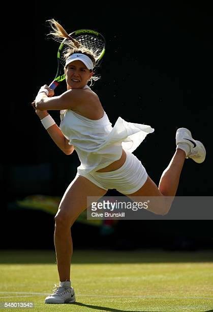 Eugenie Bouchard of Canada plays a backhand during the Ladies Singles third round match against Dominika Cibulkova of Slovakia on day six of the...