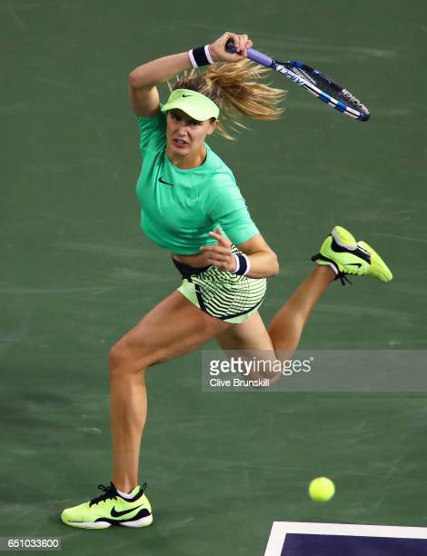 Eugenie Bouchard of Canada plays a forehand against Annika Beck of Germany in their first round match during day four of the BNP Paribas Open at...