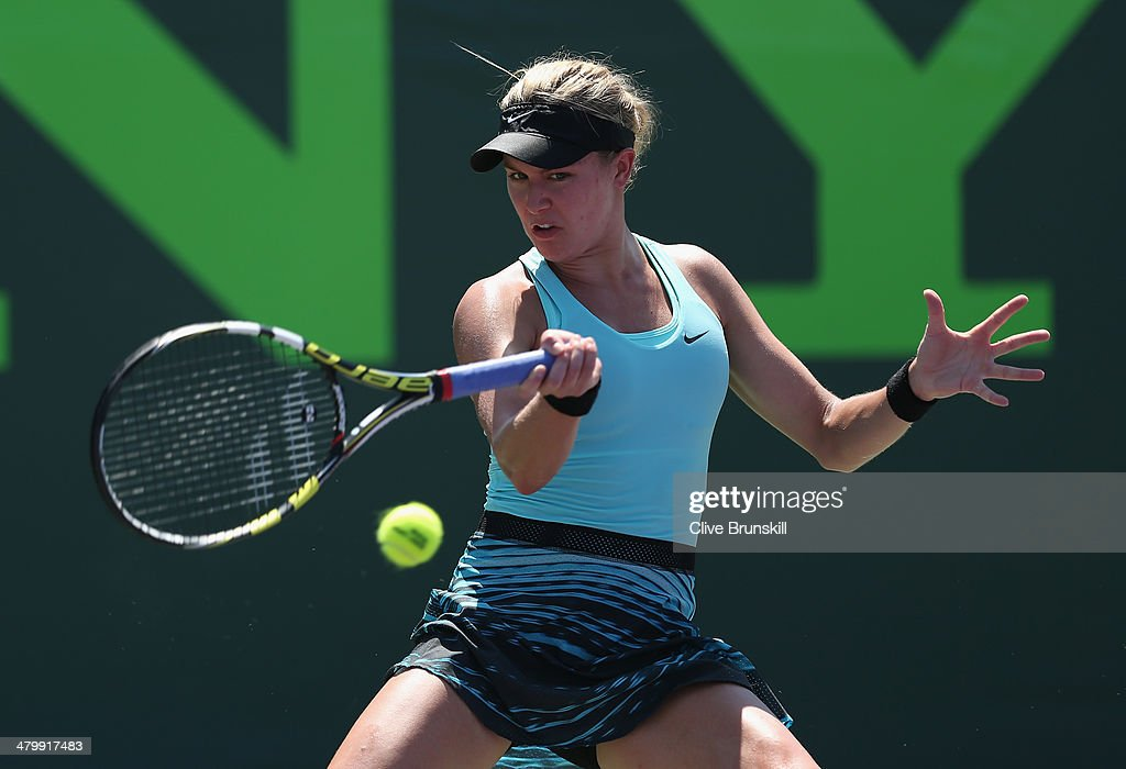 <a gi-track='captionPersonalityLinkClicked' href=/galleries/search?phrase=Eugenie+Bouchard&family=editorial&specificpeople=5678779 ng-click='$event.stopPropagation()'>Eugenie Bouchard</a> of Canada plays a forehand against Elina Svitolina of Ukraine during their second round match during day 5 at the Sony Open at Crandon Park Tennis Center on March 21, 2014 in Key Biscayne, Florida.