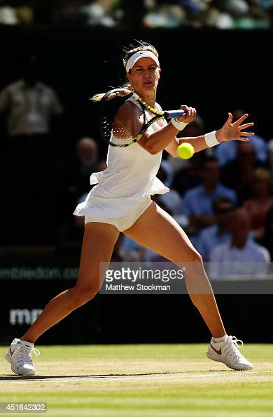 Eugenie Bouchard of Canada plays a forehand return during her Ladies' Singles semifinal match against Simona Halep of Romania on day ten of the...