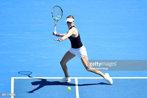 Eugenie Bouchard of Canada plays a forehand shot in her first round match against Shuai Zhang of China during the 2017 Sydney International at Sydney...