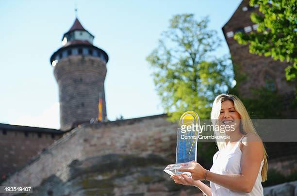 Eugenie Bouchard of Canada poses at Nuremberg Castle after winning the Nuernberger Versicherungscup in her final against Karolina Pliskova of Czech...
