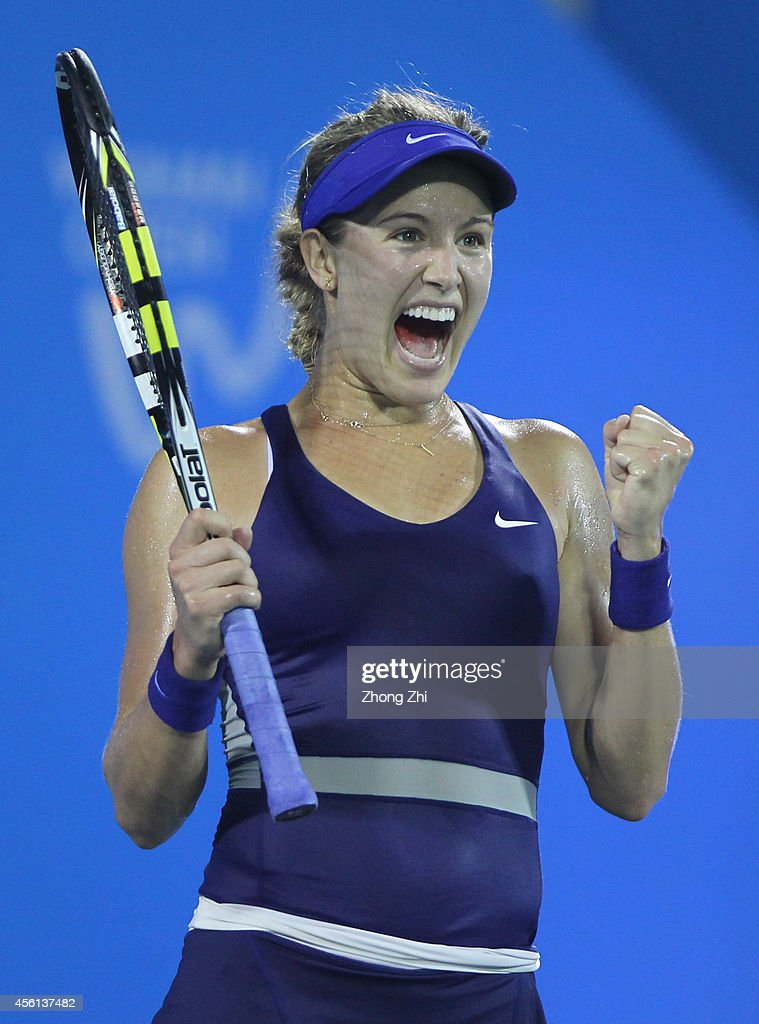 <a gi-track='captionPersonalityLinkClicked' href=/galleries/search?phrase=Eugenie+Bouchard&family=editorial&specificpeople=5678779 ng-click='$event.stopPropagation()'>Eugenie Bouchard</a> of Canada reacts after winning her match against Caroline Wozniacki of Denmark on day six of 2014 Dongfeng Motor Wuhan Open at Optics Valley International Tennis Center on September 26, 2014 in Wuhan, China.