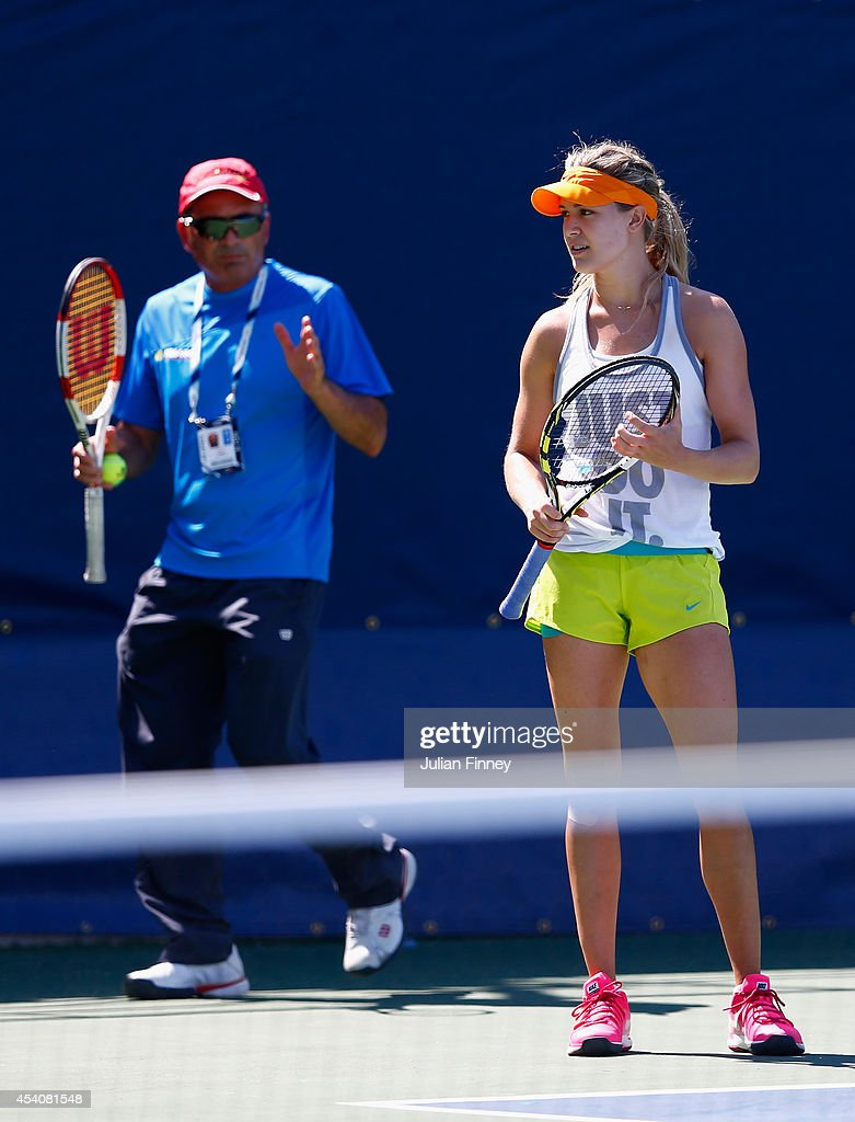 <a gi-track='captionPersonalityLinkClicked' href=/galleries/search?phrase=Eugenie+Bouchard&family=editorial&specificpeople=5678779 ng-click='$event.stopPropagation()'>Eugenie Bouchard</a> of Canada receives help from her coach during previews for the US Open tennis at USTA Billie Jean King National Tennis Center on August 24, 2014 in New York City.